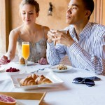 Couple Eating Luxury Breakfast